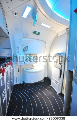 SINGAPORE - FEBRUARY 12: Side exit door in the new Boeing 787 Dreamliner at Singapore Airshow February 12, 2012 in Singapore