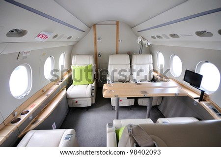 SINGAPORE - FEBRUARY 17: Spacious and luxurious cabin of a business jet on display at Singapore Airshow February 17, 2012 in Singapore