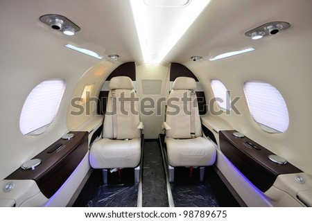 SINGAPORE - FEBRUARY 17: Spacious and posh interior of a small business jet at Singapore Airshow February 17, 2012 in Singapore