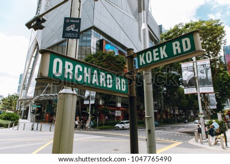 Singapore - February 19, 2018 : Street sign, Junction between Orchard road and Koek road, cross road in singapore.