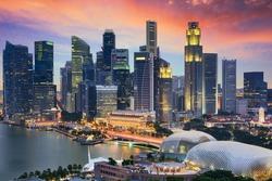 Singapore Financial District skyline at dusk.