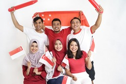 Singapore Flag Day. Young joyful group of people holds Flag of Singapore Celebrate together of Independence day