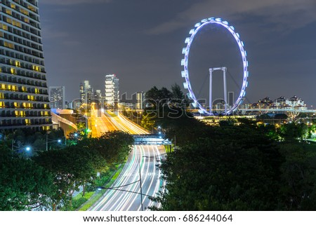 Singapore Flyer, Singapore - 15 June 2017: The Asia's largest observation wheel. Tourist can enjoy Singapore's panoramic views at 165 metres above ground level.