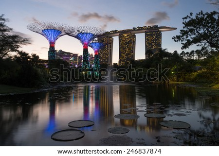 SINGAPORE - JAN 15: Gardens by the Bay at dusk on JAN 15, 2015 in Singapore. Gardens by the Bay was crowned World Building of the Year at the World Architecture Festival 2012