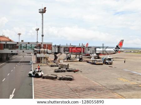 SINGAPORE - JANUARY 4:Changi International Airport, busy aviation hub in Southeast Asia on January 4, 2013 in Singapore. Changi airport throughput in 2012 was more than 50 mln passengers.