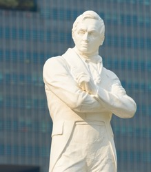 SINGAPORE - JANUARY 15, 2017: Closeup of white marble statue of Sir Stamford Raffles, founder of modern Singapore