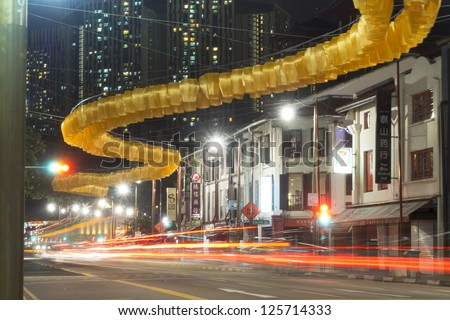 SINGAPORE - JANUARY 12: Yellow lanterns garland hanged over South Bridge Road just before Chinese New Year Celebration in Chinatown district of Singapore on January 12,  2013 in Singapore.