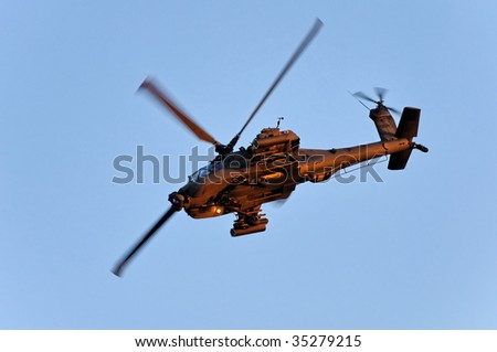 SINGAPORE - JULY 25: An Apache attack helicopter performs a stunt during Singapore National Day Parade 2009 combined rehearsal July 25, 2009 in Singapore