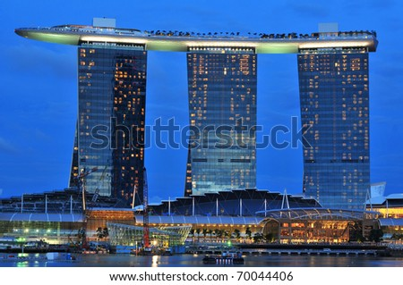 SINGAPORE - JULY 17: Fifty-five storeys high, US$ 6.3 biliion Marina Bay Sands Hotel dominates the skyline at Marina Bay July 17, 2010 in Singapore.
