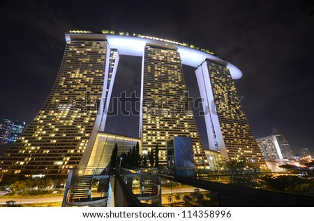 SINGAPORE-JULY 8: The Marina Bay Sands Resort Hotel on July 8, 2012 in Singapore. It is an integrated resort and the world's most expensive standalone casino property at S$8 billion. - stock photo