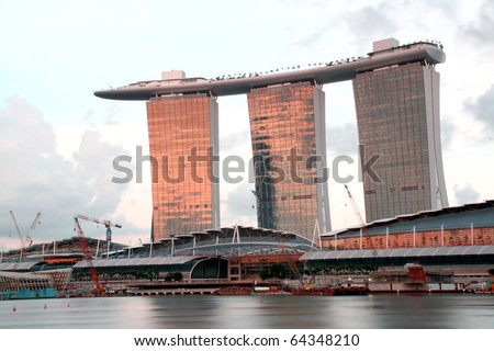 SINGAPORE - JULY 16: World's most expensive standalone casino property at US$ 6.3 billion. Marina Bay Sands Hotel dominates the skyline at Marina Bay July 16, 2010 in Singapore.