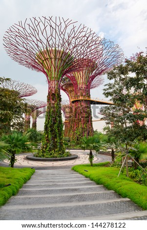 SINGAPORE - JUN 02: Gardens by the Bay at dusk on Jun 02, 2013 in Singapore. Gardens by the Bay was crowned World Building of the Year at the World Architecture Festival 2012.