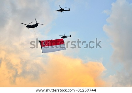 SINGAPORE - JUNE 25: Chinook helicopter flying Singapore national flag at National Day Parade Singapore 2011 Combined Rehearsal on June 25, 2011 in Singapore.