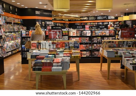 SINGAPORE-JUNE 14: Customers shop for books in Changi Airport, Singapore on June 14, 2013. Singapore airport provides the best shopping experience to the passengers.