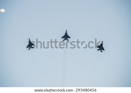 Singapore - june 27, 2015:Fiftieth anniversary of the Singapore National Day rehearsal, fighter formation flew over the city