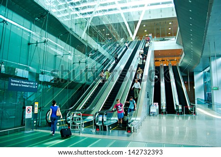 SINGAPORE - MARCH 05 : Escalators at Changi International Airport on March 05, 2013 in Singapore. Changi Airport serves more than 100 airlines operating 6,100 weekly flights