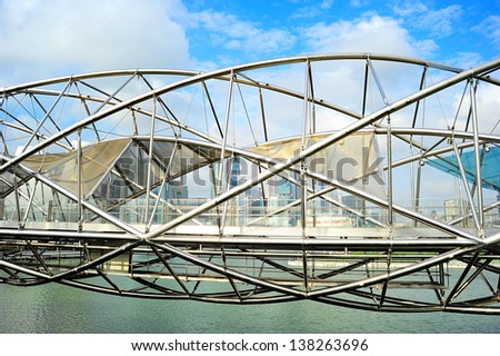 SINGAPORE - MARCH 08: The Helix Bridge on March 08, 2013 in Singapore. Is a bridge in the Marina Bay. The Helix is fabricated from 650 tonnes of Duplex Stainless Steel and 1000 tonnes of carbon steel - stock photo