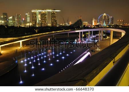 Singapore Marina Barrage against skyline at night