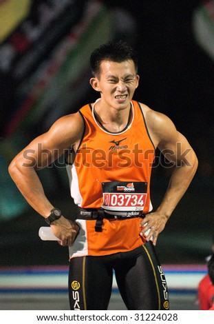 SINGAPORE - 31 May: Marathon finisher in the Adidas SUNDOWN MARATHON ...