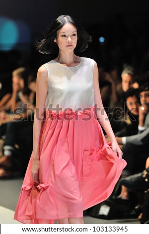 SINGAPORE - MAY 18: Model showcasing design by Saena from Berlin at Audi Fashion Festival 2012 on May 18, 2012 in Singapore