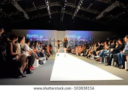 SINGAPORE - MAY 18: Models walking along the runway, showcasing designs by Swarovski (Kingdom of Jewels) at Audi Fashion Festival 2012 Swarovski Show on May 18, 2012 in Singapore.