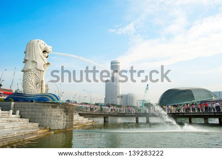 SINGAPORE - MAY 08: The Merlion fountain in front of Esplanade Theatres on the Bay on May 08, 2013 in Singapore. Merlion is a imaginary creature with the head of a lion, seen as a symbol of Singapore