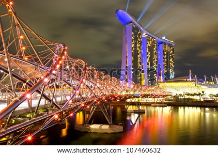 SINGAPORE - MAY 13 2012: World's most expensive standalone casino property at US$ 6.3 billion. Marina Bay Sands Hotel dominates the skyline at Marina Bay May 13, 2010 in Singapore.