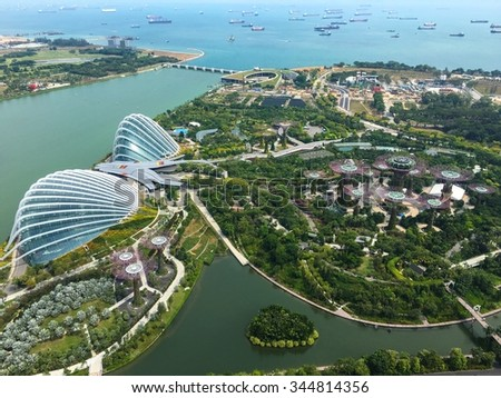 Singapore - Nov 13: Aerial View of the two domes of Gardens by the Bay park, Singapore with Marina Bay Sands tower. November 13, 2015 #344814356