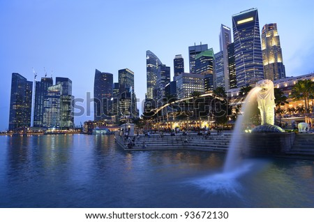 SINGAPORE-NOV 11: The Merlion fountain and Singapore skyline on Nov 11, 2011. Merlion is an imaginary creature with a head of a lion and the body of a fish and is often seen as a symbol of Singapore