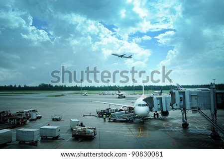 SINGAPORE - NOVEMBER 26: An aircraft parking at Changi airport on November 26, 2011 in Singapore. Changi Airport 42 million passengers a year. it is busiest airport in the world & best asia airport.