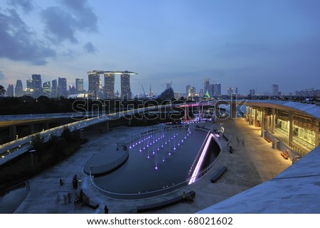 SINGAPORE - NOVEMBER 21: Singapore Marina Barrage against skyline at night November 21, 2010 in Singapore.