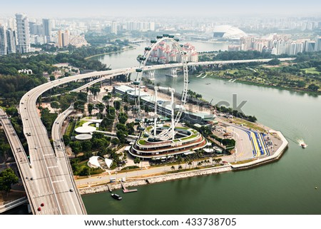 SINGAPORE - OCTOBER 18, 2014: Singapore Flyer, view from Marina Bay Sands Skypark. #433738705