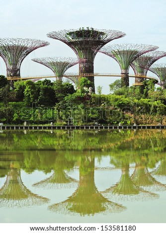 Singapore, Republic of Singapore - May 09, 2013: People walking on the bridge at Gardens by the Bay. Gardens by the Bay was crowned World Building of the Year at the World Architecture Festival 2012