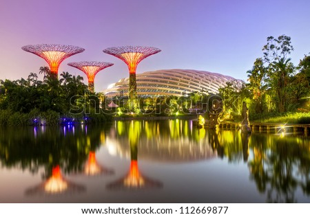 SINGAPORE - SEPT 07: Night view of Supertree Grove at Gardens by the Bay on Sept 07, 2012 in Singapore. Spanning 101 hectares of reclaimed land in central Singapore, adjacent to the Marina Reservoir.