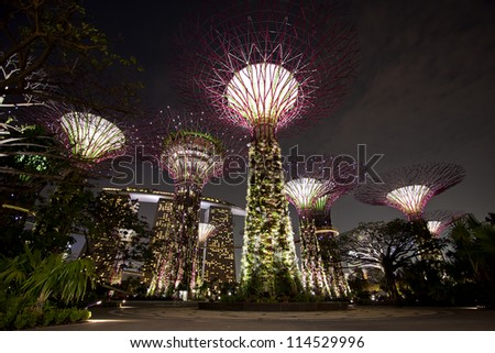SINGAPORE - SEPTEMBER 10 : A night view of the Supertrees Grove, Cloud Forest & Flower Dome at Gardens by the Bay on September 10, 2012 in Singapore.