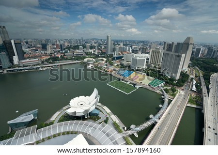 SINGAPORE - SEPTEMBER 16: An aerial view of Singapore's business district and tourist attraction on September 16, 2013 in Singapore. Singapore is also South East Asia's financial capital. - stock photo