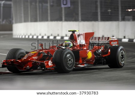 SINGAPORE - SEPTEMBER 26: Ferrari's Felipe Massa races at the 2008 Singtel Singapore F1 Grand Prix on September 26, 2008 in Marina Bay Circuit, Singapore.
