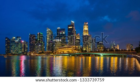 Singapore, Singapore - APRIL 3, 2019: View at Singapore City Skyline at dusk, which is the iconic landmarks of Singapore #1333739759