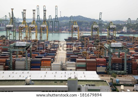SINGAPORE, SINGAPORE -FEB 12, 2014: Port of Singapore with Container Ships Loading and Unloading Containers at shipyard. Singapore is the second busiest port in the world in terms of tonnage.