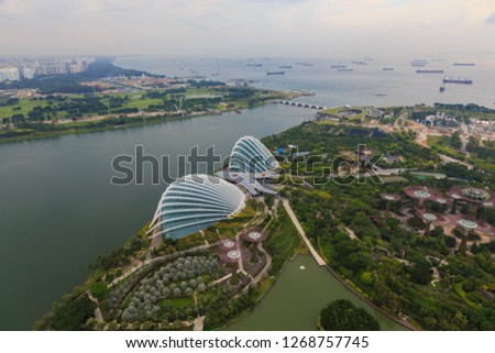 Singapore,Singapore-October 25, 2018 :  Beautiful and Amazing Singapore Skyline view from Sands Skypark, Marina Bay Sands Hotel. Singapore It is a global commerce, finance and transport hub  #1268757745