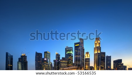 Singapore Skyline HDR panoramic with blue sky for copyspace