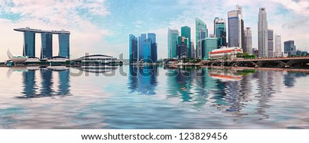 Singapore skyline - modern skyscrapers with reflection in water