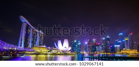 Singapore skyline with urban buildings over water #1029067141