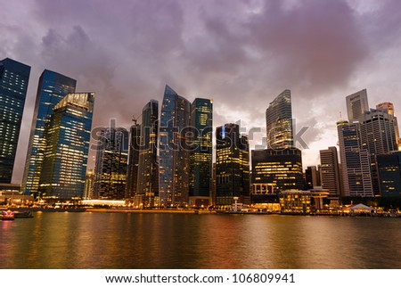 Singapore skyscrapers in downtown at evening time.
