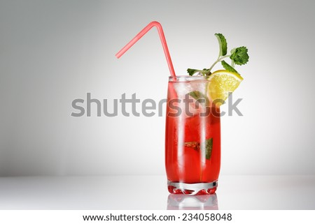 Singapore Sling cocktail with mint on gradient background