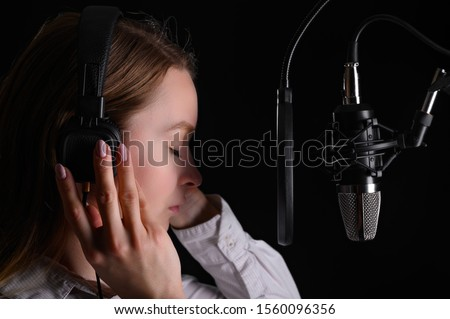 Singer, blogger, voice acting. Work in the studio with a studio microphone.