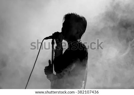 Singer in silhouette