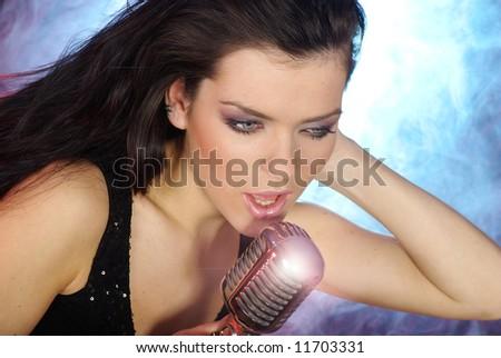 Singer .Sexy woman  singing in retro mic - stock photo