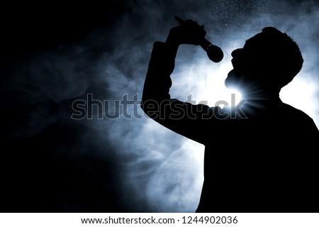 Singer singing silhouette ストックフォト ©