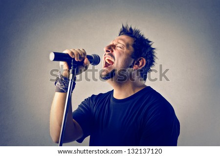 singer singing with microphone